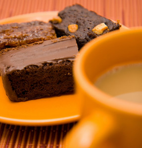 Chocolate Brownie And A Cup Of Coffee
