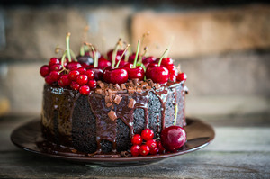 Chocolate Cake With Cherries On Wooden Background