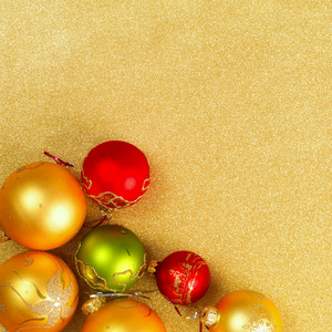 Abstract Christmas gold background with golden holiday balls