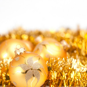 Christmas balls and toys decorations background in gold colors