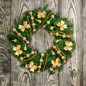 Christmas wreath on a rustic wooden front door
