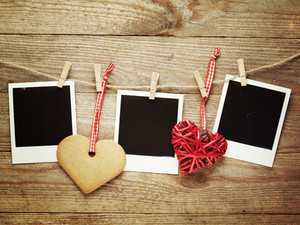 Polaroids decorated for Christmas on the wooden board background with space for your text