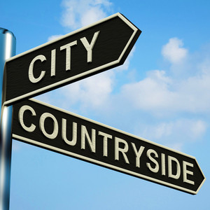 City Or Countryside Directions On A Signpost