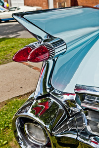 Classic car vintage tail lights and rear chrome bumper.
