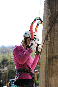 Climbing on the mountain, female doing extreme sport