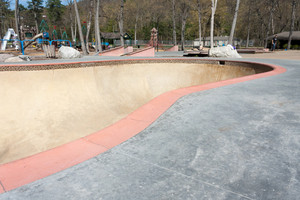 Close up detail of an empty skate park bowl ramp.