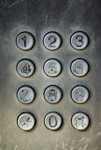 Close up image of a public pay phone keypad