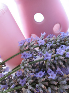 Close Up Lavender And A Bottle Of Body Lotion
