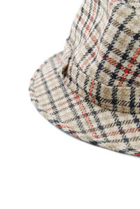 Close-up Of A Checked Brown Hat On White
