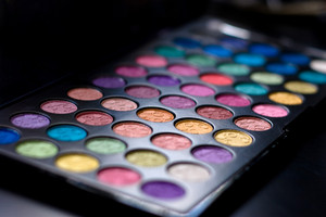 Close up of a colorful assortment of eye shadow cosmetics.  Shallow depth of field.