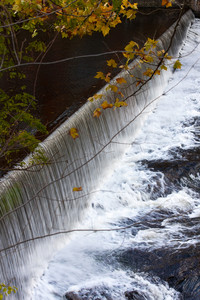 Close up of a long flowing waterfall during the fall months.