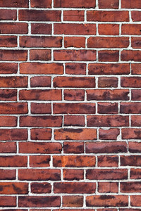 Close up of a red brick wall that makes a great background texture.