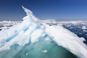 Close up of a sunlit ice floe in a field of floes
