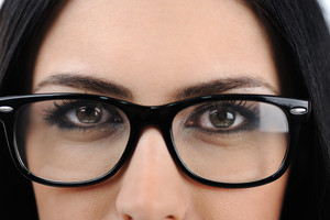 Close-up of a young woman wearing glasses