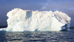 Close up of an iceberg along the foggy coast