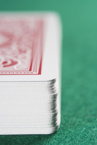 Close up of deck of cards on green baize