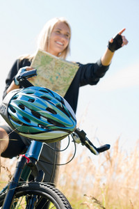 Close-up of helmet mountain biking young woman search in map
