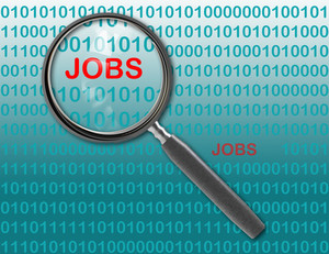 Close Up Of Magnifying Glass On Jobs