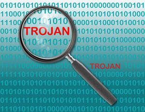 Close Up Of Magnifying Glass On Trojan