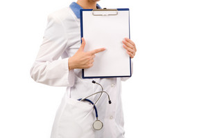 Close-up of nurse pointing at blank paper in hands