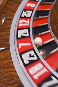 Close up of spinning roulette wheel with ball in number seven