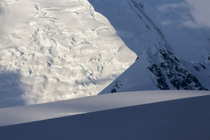 Close up of sunlit, snowy mountains