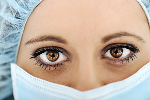 Close-up of urgent medic eye female doctor