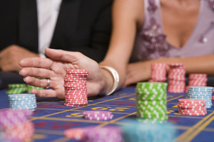Close up of woman placing bet on roulette table in casino