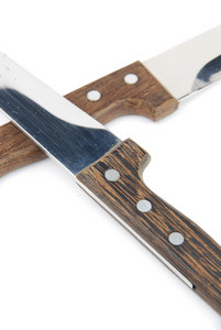 Close-up Of Wooden Kitchen Knifes On White