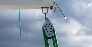 Close up of yacht equipment. Part of yacht with ropes and capstan