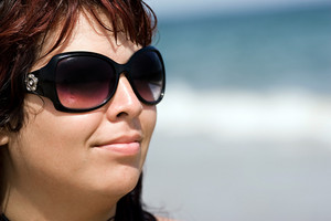 Close-up portrait of a beautiful plus size model at the beach.