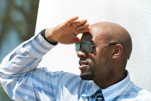 Close up portrait of a confident business man wearing sunglasses in the city.