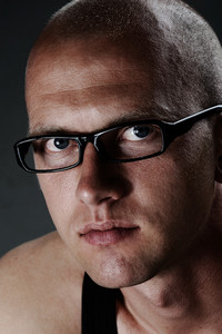 Close up portrait of a man with glasses