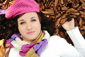 Close-up portrait of an beautiful autumn woman laying on ground