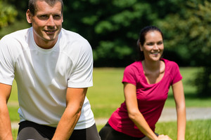 Close up portrait of smiling couple stretching outdoors