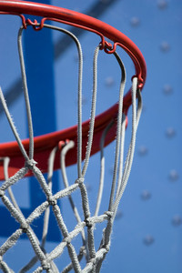 Closeup detail of a playground basketball goal and net.  Shallow depth of field.