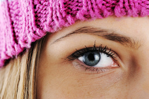 Closeup eye of Happy Winter Beautiful Girl