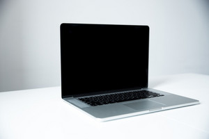 Closeup image of a laptop on the table in office over gray background