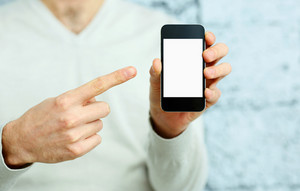 Closeup image of a male hand pointing at smartphone display