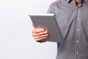 Closeup image of a man holding tablet computer