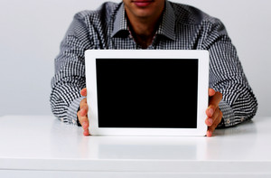 Closeup image of a man showing tablet comptuter screen