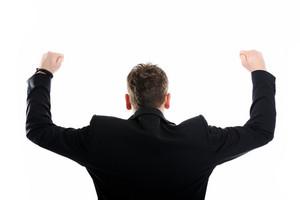 Closeup image of a man standing back