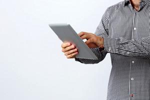 Closeup image of a man using tablet computer