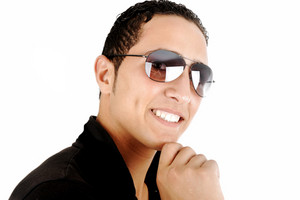 Closeup image of a middle eastern guy wearing sunglasses