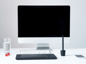 Closeup image of a personal computer with graphic tablet on the table in office
