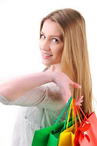 Closeup image of a teen girl holding shopping bags