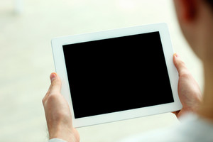 Closeup image of male hands showing screen of tablet computer isolated on a white background