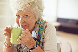 Closeup of a happy senior woman drinking tea