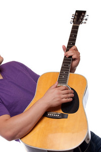Closeup of a mans hands strumming and electric acoustic guitar isolated over a white background.