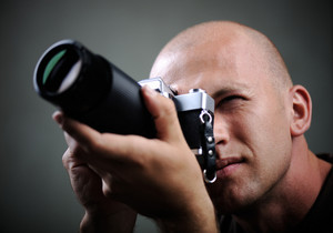 Closeup of a photographer with camera